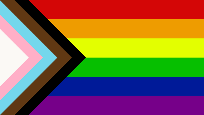 Progress Pride flag, including original rainbow design, trans flag elements and black and brown stripes for racial justice.